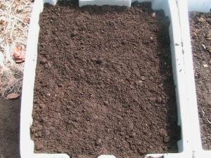Layering Soil in Totes